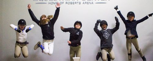 kids jumping on winners circle