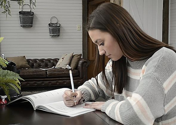 wilmington equestrian dragonfly academy student doing school work