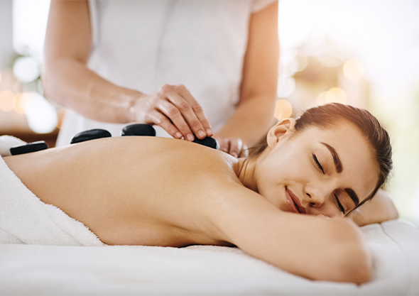 ocala equestrian spa woman getting stone massage