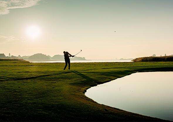 golden ocala gold and equestrian club golfer swinging sunset